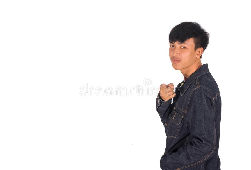 Młody azjatykci mężczyzna wskazuje jego palec kamera obrazy stock