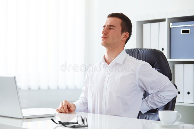 Młody biznesmen backache obraz stock