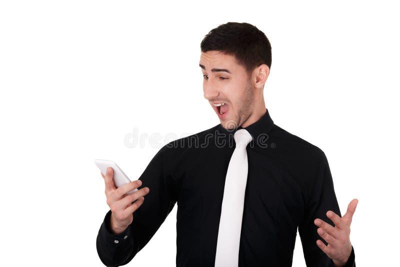 Młody biznesmen Patrzeje Zaskakujący przy Jego Mądrze telefonem zdjęcia stock