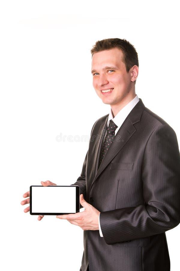 Młody biznesmen pokazuje pastylka komputeru osobisty comuter z pustym ekranem dla twój próbka teksta zdjęcia stock