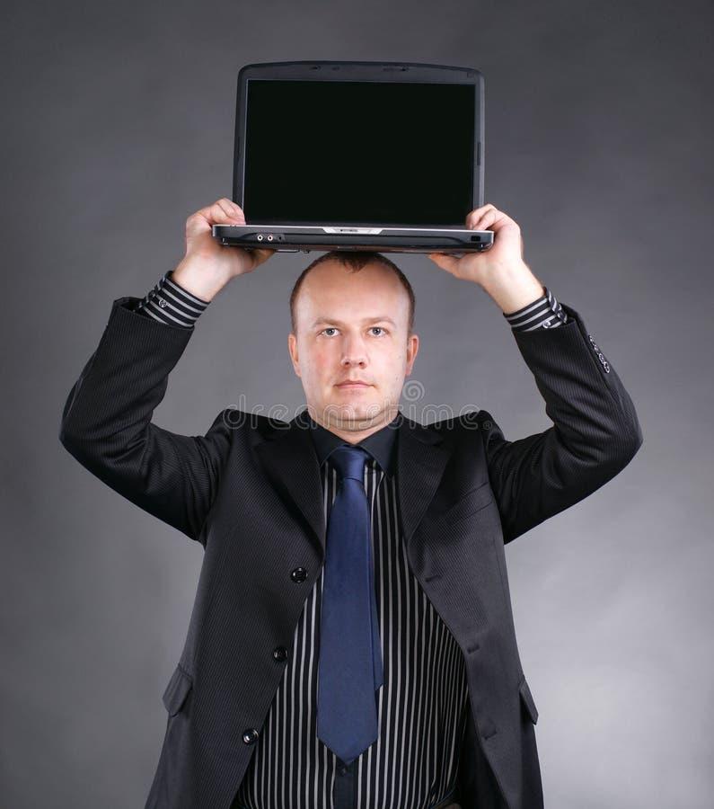 Download Młody Biznesmena Mienia Laptop Na Jego Głowie Obraz Stock - Obraz złożonej z oczy, laptop: 28969105