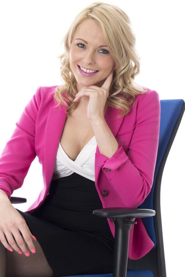 Młody Biznesowej kobiety obsiadanie na Biurowym krześle zdjęcie stock