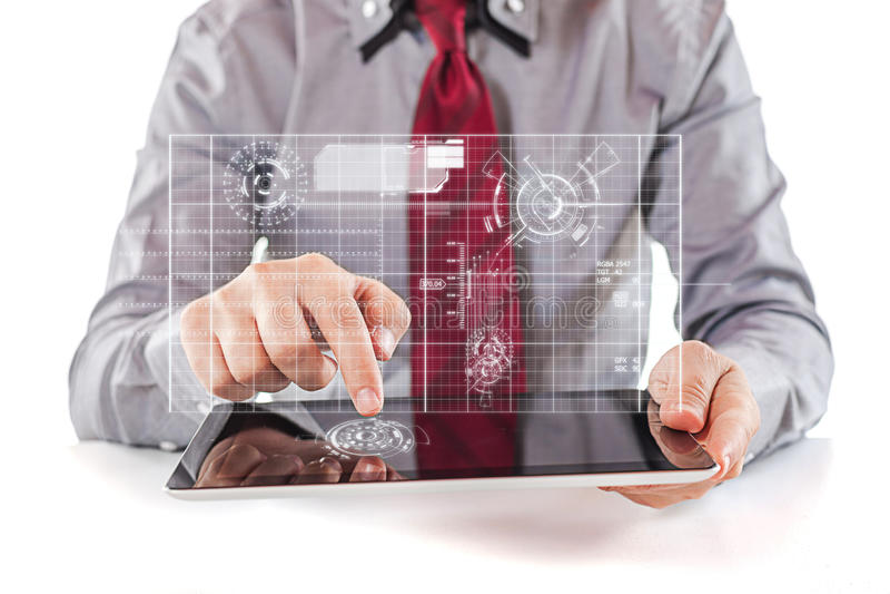 Młody biznesowy mężczyzna używa cyfrową komputer osobisty pastylkę zdjęcia royalty free