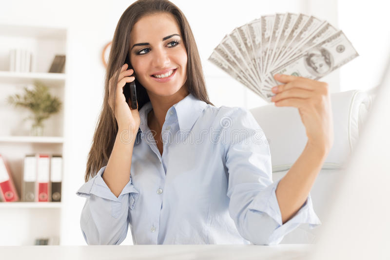 Młody bizneswoman Z dolarami zdjęcie royalty free