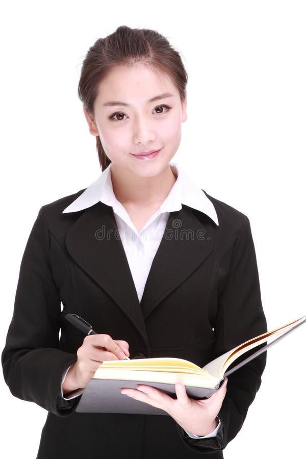 Młody bizneswoman z piórem zdjęcia royalty free