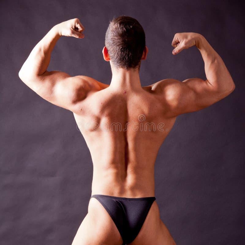 Młody bodybuilder pozować fotografia stock