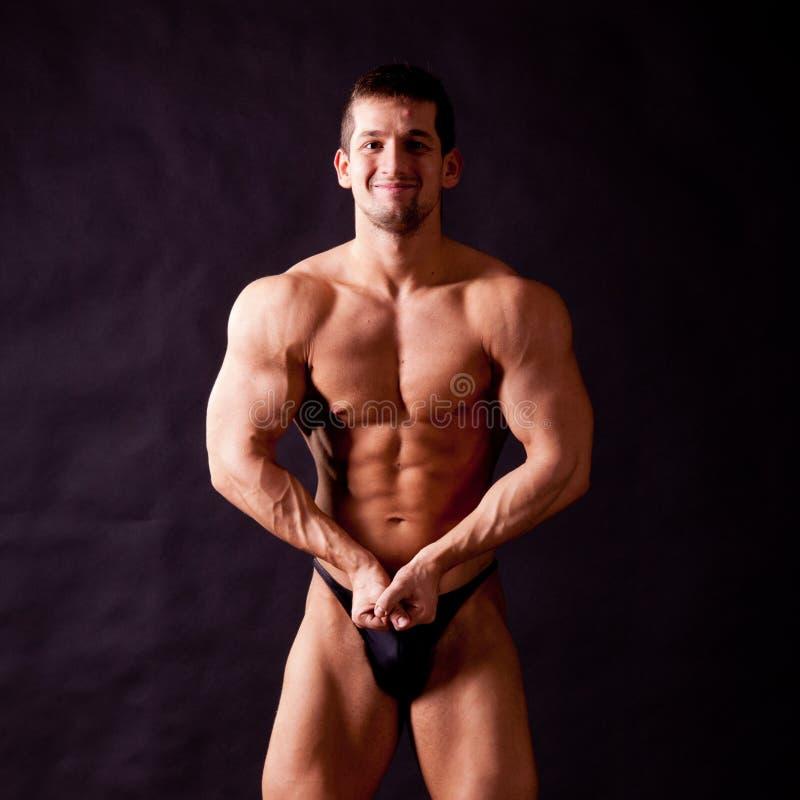 Młody bodybuilder pozować obraz stock