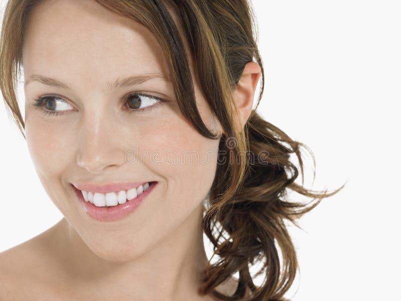 Młody brunetki kobiety ono Uśmiecha się obrazy stock