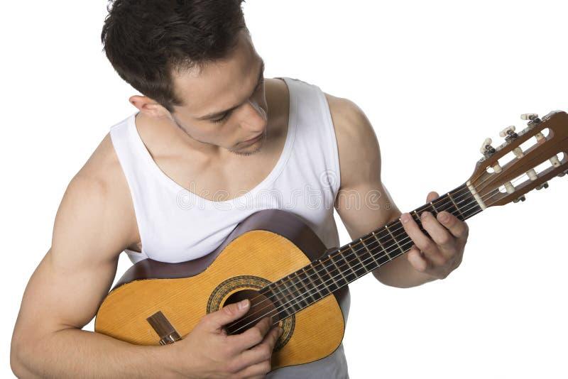Młody Człowiek Bawić się gitarę fotografia stock