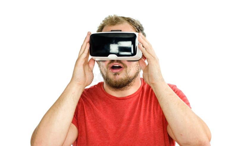 Młody człowiek jest ubranym rzeczywistości wirtualnej googles/VR szkła fotografia royalty free