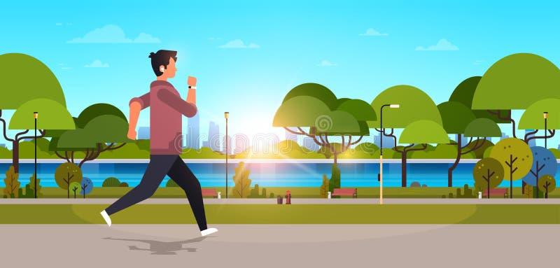 Młody człowiek jogging outdoors nowożytnego jawnego parka faceta biega sport aktywności pojęcia pejzażu miejskiego zmierzch w heł ilustracji