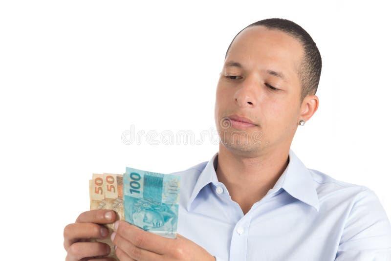 Młody człowiek liczy pieniądze fotografia royalty free