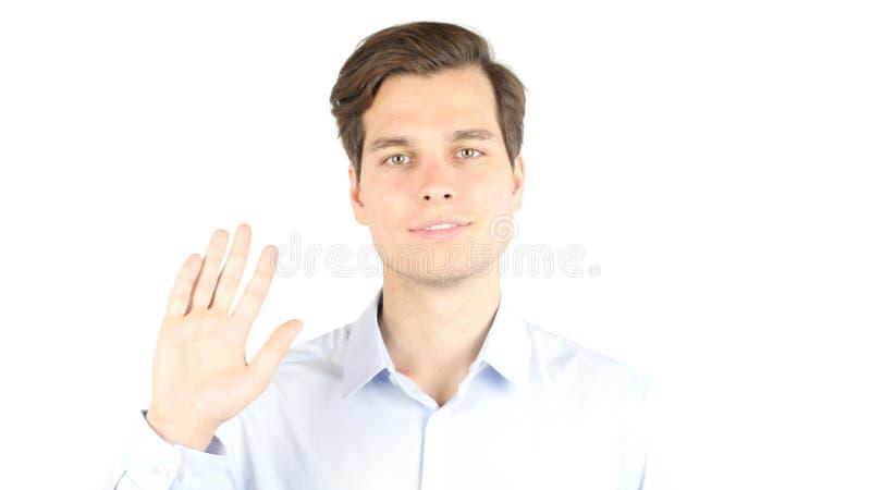 Młody człowiek mówi w kamerze cześć, odosobniony biały tło obraz stock