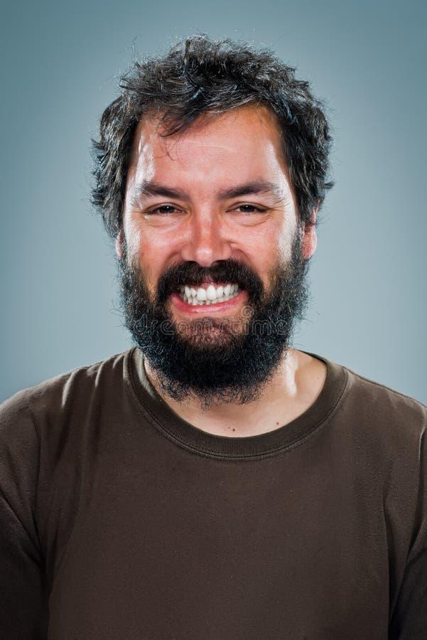 Młody Człowiek ono Uśmiecha się z Ciemną brodą fotografia stock
