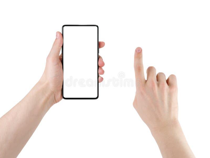 Młody człowiek ręki mienia bezel mniej smartphone z dotyk ręką odizolowywającą na bielu zdjęcia stock