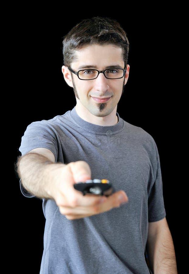 Młody człowiek używać pilot do tv fotografia royalty free