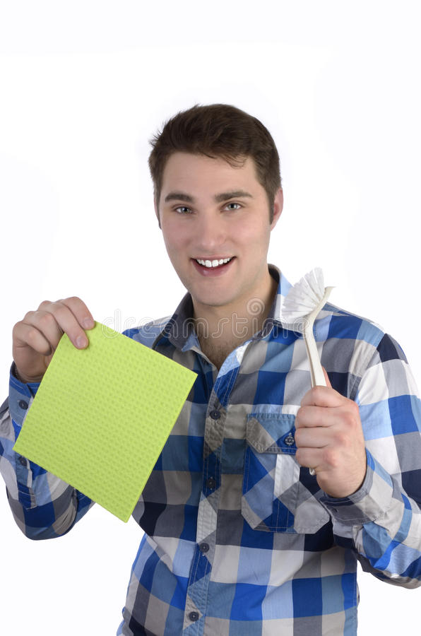 Młody człowiek w błękitnej koszula z cleaning naczyniami zdjęcie royalty free