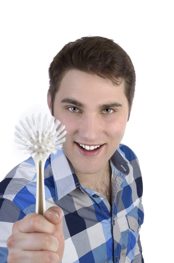Młody człowiek w błękitnej koszula z muśnięciem obraz stock