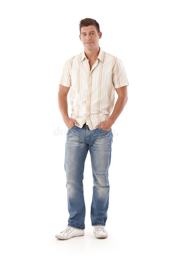 Młody człowiek w cajgach i koszula obrazy stock