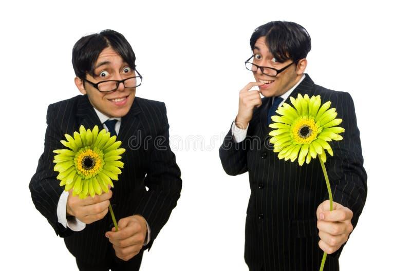 Młody człowiek w czarnym kostiumu z kwiatem odizolowywającym na bielu obrazy royalty free