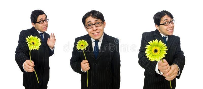 Młody człowiek w czarnym kostiumu z kwiatem odizolowywającym na bielu obraz royalty free