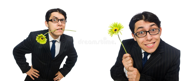 Młody człowiek w czarnym kostiumu z kwiatem odizolowywającym na bielu zdjęcia stock