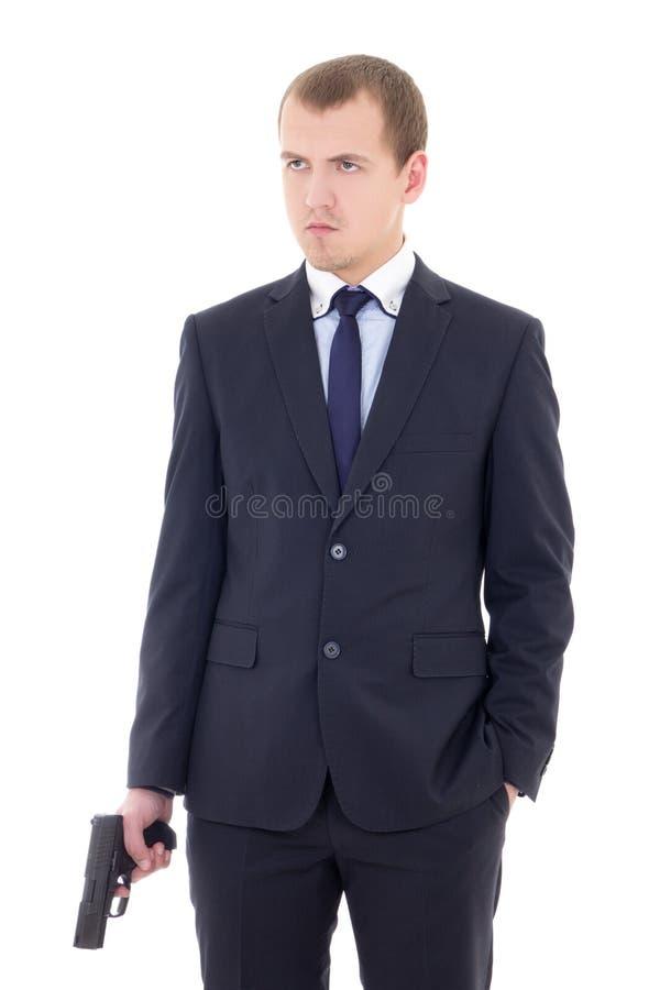 Młody człowiek w garniturze z pistolecikiem odizolowywającym na bielu obraz royalty free