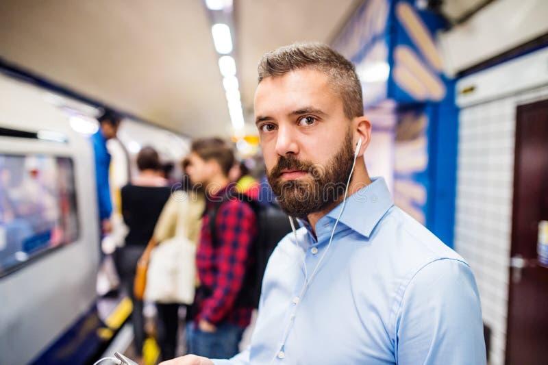 Download Młody człowiek w metrze obraz stock. Obraz złożonej z stacja - 65225909