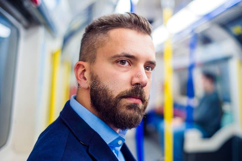 Download Młody człowiek w metrze zdjęcie stock. Obraz złożonej z modniś - 65225960