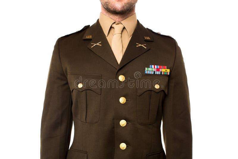 Młody człowiek w wojskowym uniformu, cropped wizerunek obrazy royalty free