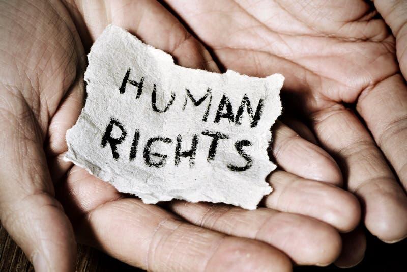 Młody człowiek z papierem z tekstów prawami człowieka zdjęcie royalty free