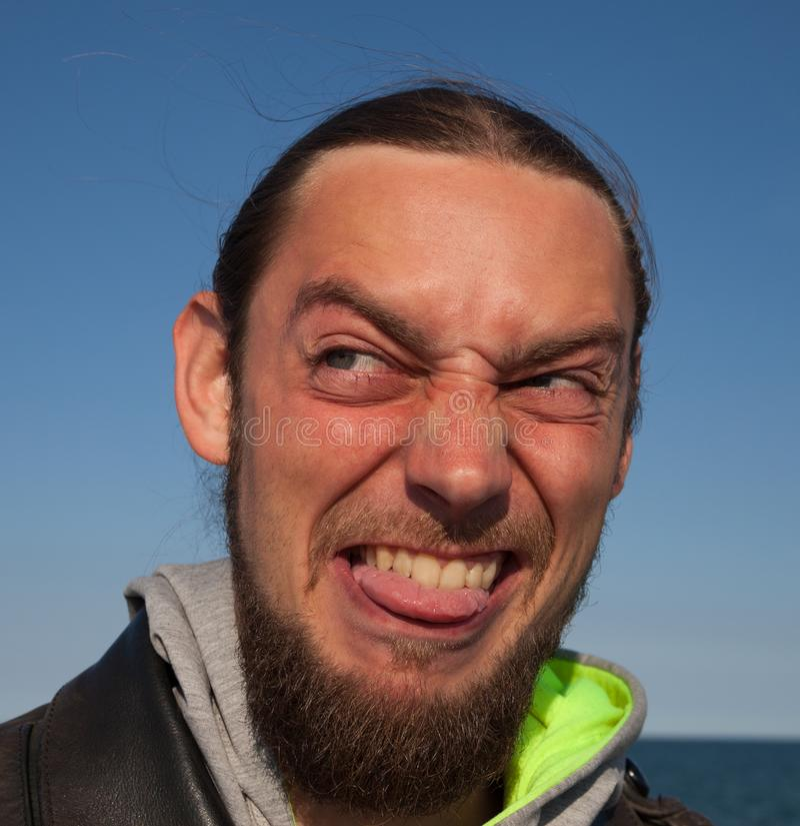 Młody człowiek zrobił brzydkiej twarzy fotografia stock