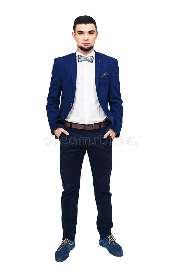 Młody elegancki mężczyzna w błękitnym kostiumu, ufny pomyślny biznesmen lub showman, obraz royalty free