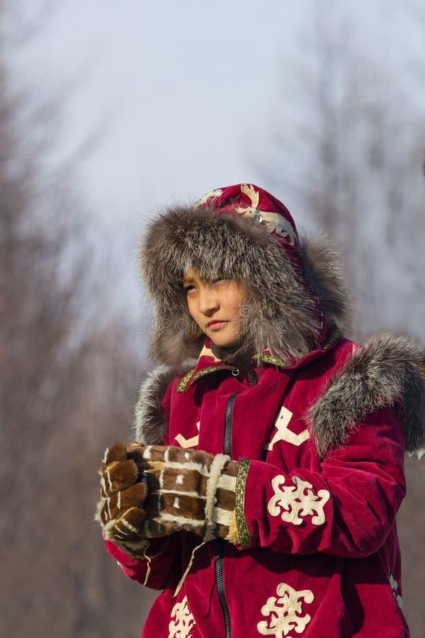 Młody Evenk w krajowym kostiumu obrazy stock