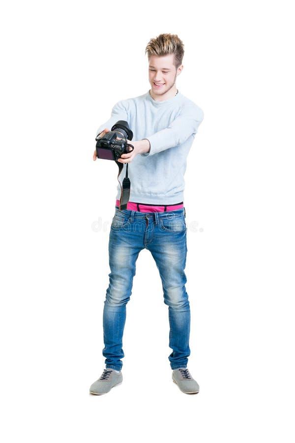 Młody fotograf trzyma dslr kamerę obraz royalty free
