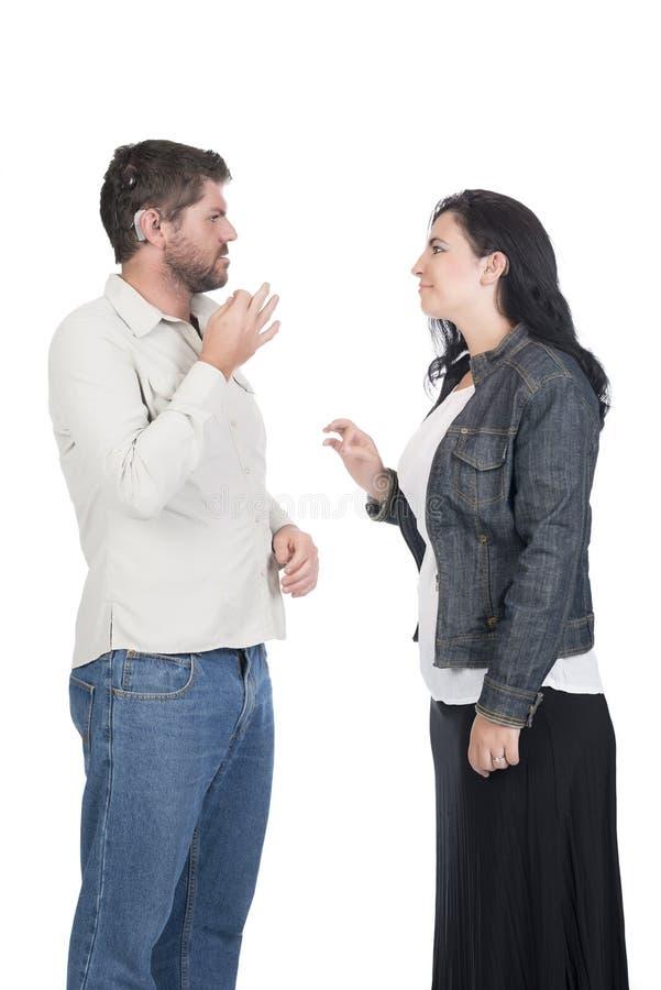 Młody głuchy lub przesłuchanie - nadwyrężony pary lub rodzeństw podpisywać zdjęcie royalty free