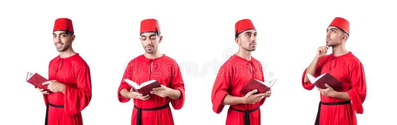 Młody gniewny z książką na bielu zdjęcia stock