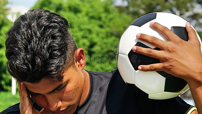 Młody Latynoski Męski gracz piłki nożnej I smucenie zdjęcia royalty free
