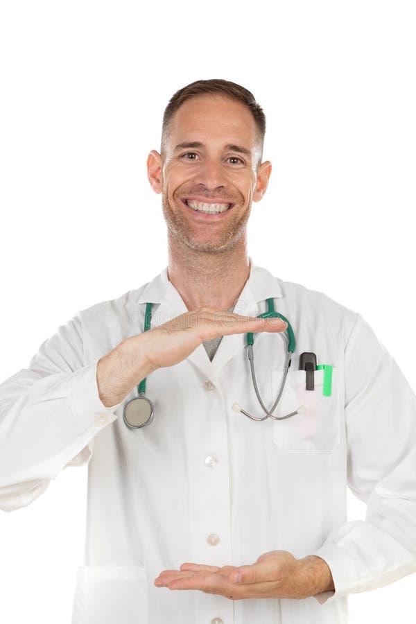 Młody lekarz trzymający coś w dłoniach obrazy stock