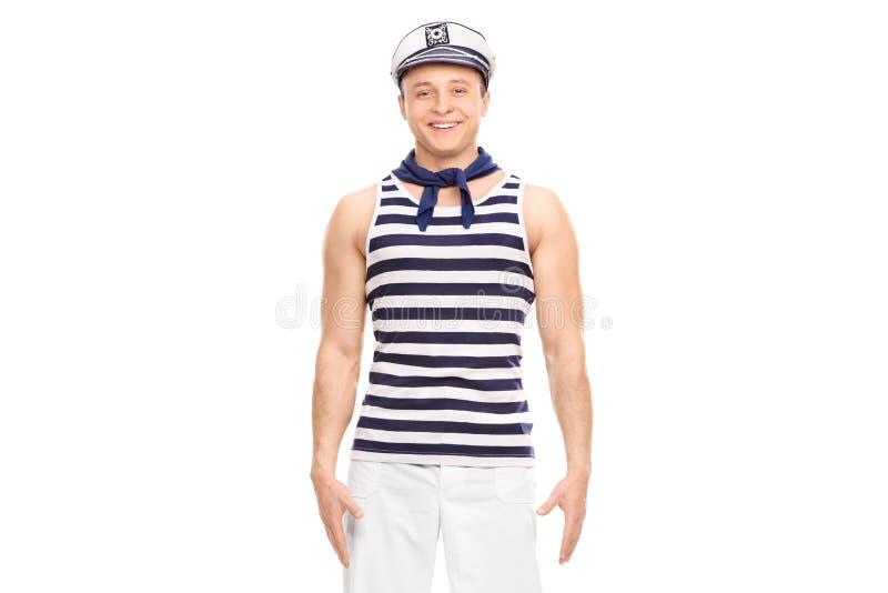 Młody męski żeglarza stać prosty i uśmiechnięty zdjęcie royalty free