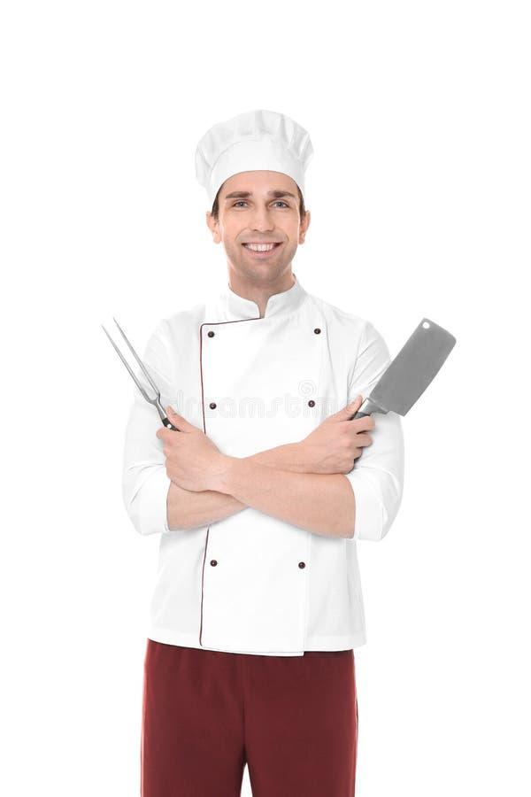 Młody męski szef kuchni z mięsnym rozwidleniem i nożem odizolowywającymi, obraz stock