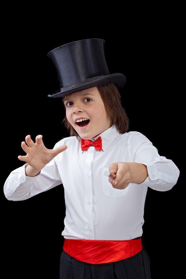 Młody magik w przebraniu sztuczki obraz stock