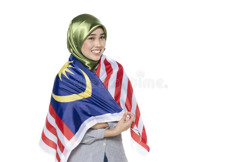 Młody malezyjski cywil z szczęśliwym twarzy odświętności bezpartyjnikiem obrazy stock