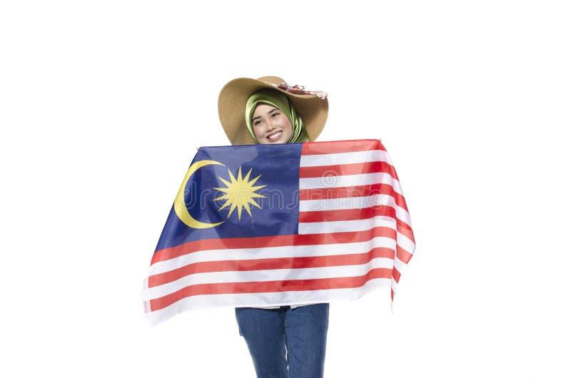 Młody malezyjski cywil z szczęśliwym twarzy odświętności bezpartyjnikiem zdjęcia stock