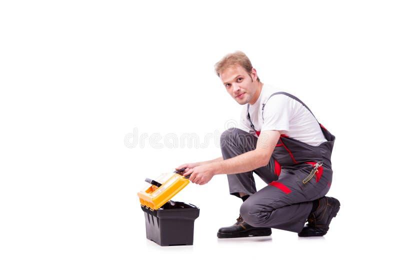 Młody pracownik budowlany jest ubranym coveralls odizolowywających na bielu fotografia royalty free