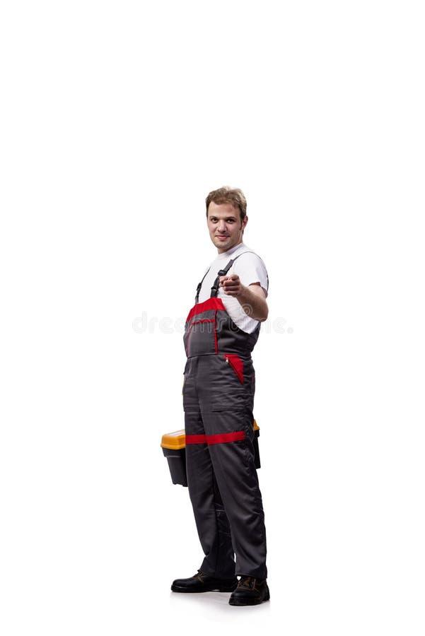 Młody pracownik budowlany jest ubranym coveralls odizolowywających na bielu zdjęcie stock