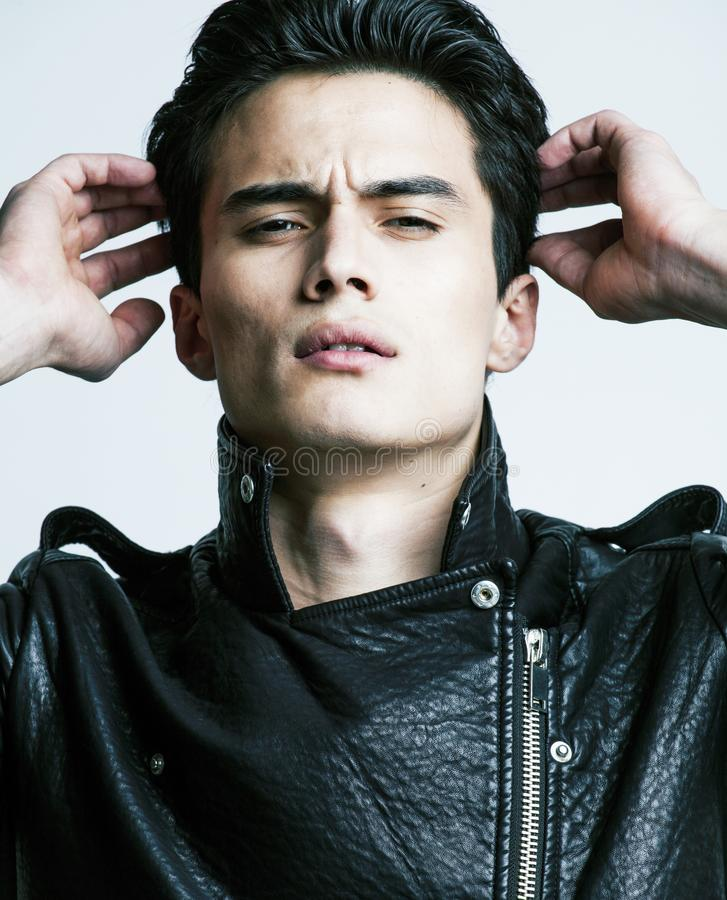 Młody przystojny azjatykci mężczyzna, skóra jacked na nagiej półpostaci, emocja zdjęcia royalty free