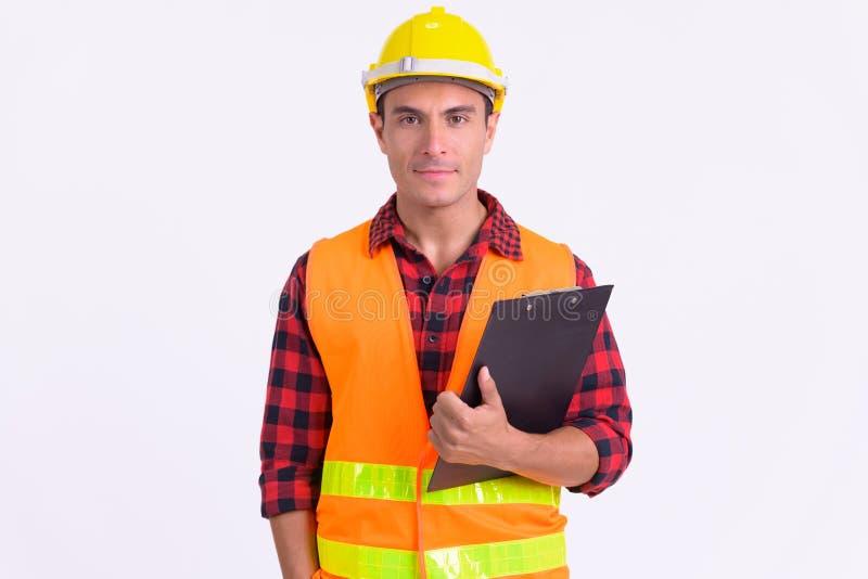 Młody przystojny Latynoski mężczyzny pracownika budowlanego mienia schowek obraz royalty free