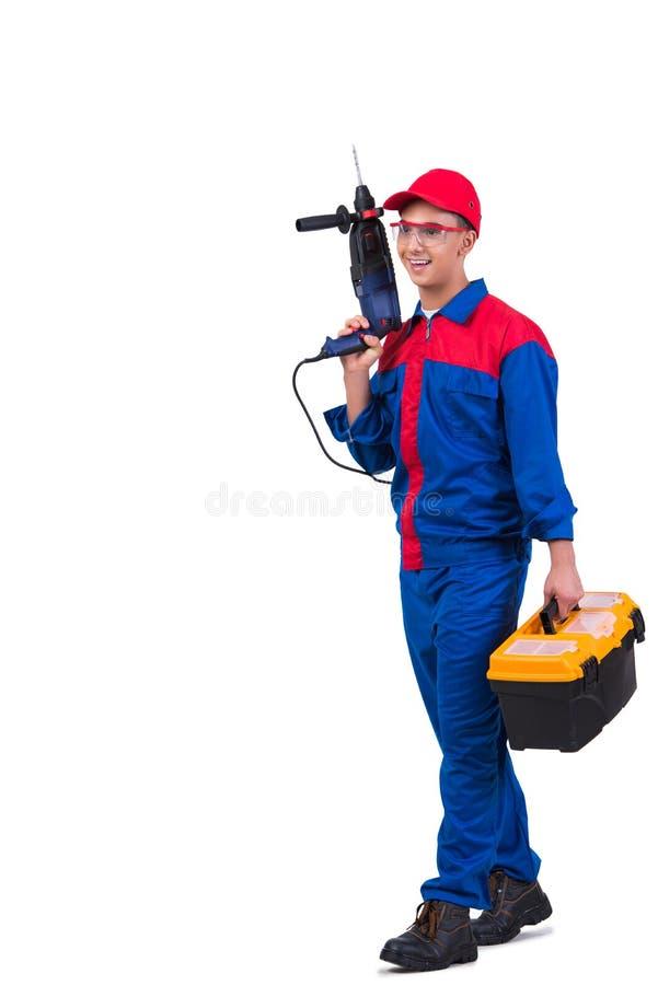 Młody repairman z świderu perforatorem odizolowywającym na bielu zdjęcia royalty free