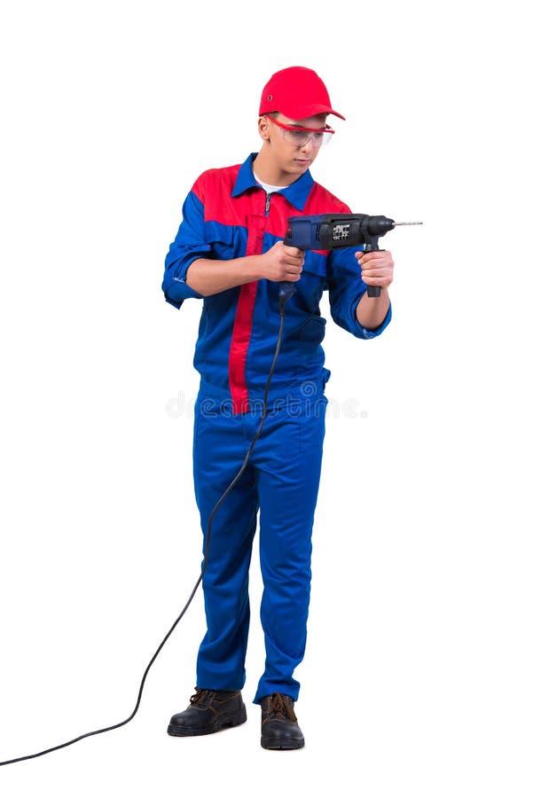 Młody repairman z świderu perforatorem odizolowywającym na bielu obraz royalty free